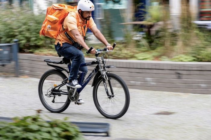 A job is a job, says an Afghan minister who became a bicycle courier in Germany
